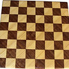 "Cbd Tiny Hb-Wal <br />    This chess board is 8 1/2"" square. Each square is just over 1"" and is made with 2 triangles back to back.  Two types of wood are in the chessboard. The dark square is ""Walnut"" from Missouri; the light square is ""Hackberry"" from Missouri.  There are 128 pieces in the over lay using two kinds of wood.<br /> <br />    Also on the back, I signed it, listed the wood, and dated it. After the date, the words ""Foot Cut"" lets you know it was made on a foot powered table saw."