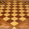 "Cbd Hb-Bub with Star 3<br />   This chessboard is 11 3/4"" square. Over all the board is 17 ¼"" square. Each square is just under 1 1/2"" and is made with 4 triangles.  Two types of wood are in the chessboard. six kinds of wood are on the whole board.  The dark square is ""Bubinga"" from West Africa; the light square is ""Hackberry"" from Missouri. ""Elm"" from Missouri is around the chessboard itself. The design in each corner is a variation of a ""Rolling Star"" quilt pattern. The wood on it, from the center of the star is ""Walnut"" and ""Maple"" from Missouri, ""Wenge"" from West Africa and then the ""Elm"". There are 560 pieces in the over lay, using 6 kinds of wood.<br /> <br /> Also on the back, I signed it, listed the wood, and dated it. After the date the words ""Foot Cut"" let you know I made it on my foot powered table saw. <br />   <br />    This gives a completely different look to a chessboard.  When not being used as a chessboard, it is made to hang on the wall from one corner.  They make a very beautiful wall hanging."