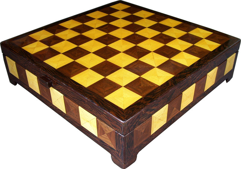 """CBox Hb-Wal-Wenge<br />    This Chess Box is about 13"""" x 13"""" and 3 5/8"""" high on the outside. Inside it is 12 1/4"""" x 12 1/4"""" x 2"""".  I made it using 612 pieces of wood cut in triangle shapes from different kinds of wood. Each square is 1 ½"""" and is made by using four triangles. This makes a design within each square and gives it a completely different look. The box is finished in its natural color with 8 or 10 coats of varnish on the top. Then the sides were sanded and 5 or 6 coats of wiping varnish were rubbed in by hand. After the top had hardened for at least a month, I leveled it and buffed to a high shine. This does give the top a more amber look than the sides but gives it a """"glass smooth"""" feel on the top. The pieces are a bit over 3/16"""" thick, glued onto a Baltic Birch base, so they hold up much better than a thin veneer.<br />    The type of wood is listed on the bottom of the box from the center out. On this box the wood is """"Hackberry"""" and """"Walnut"""" from Missouri and """"Wenge"""" from West Africa.<br />    On the bottom I signed it, listed the wood, and dated it.  After the date, the words """"Foot Cut"""" let you know I made it on a foot powered table saw.<br />  <br />    I lined the bottom of the box with black velveteen."""