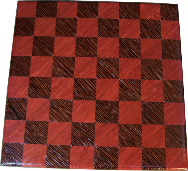 """Cbd Tiny Ph-Wenge <br />   This chess board is 8 1/2"""" square. Each square is just over 1"""" and is made with 2 triangles back to back.  Two types of wood are in the chessboard. The dark square is """"Wenge"""" from West Africa; the light square is """"Purple heart"""" from Central or South America. There are 128 pieces in the over lay using two kinds of wood. The edges are rounded with no border.<br /> <br />    Also on the back, I signed it, listed the wood, and dated it. After the date the words """"Foot Cut"""" lets you know it was made on the foot powered table saw."""