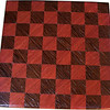 "Cbd Tiny Ph-Wenge <br />   This chess board is 8 1/2"" square. Each square is just over 1"" and is made with 2 triangles back to back.  Two types of wood are in the chessboard. The dark square is ""Wenge"" from West Africa; the light square is ""Purple heart"" from Central or South America. There are 128 pieces in the over lay using two kinds of wood. The edges are rounded with no border.<br /> <br />    Also on the back, I signed it, listed the wood, and dated it. After the date the words ""Foot Cut"" lets you know it was made on the foot powered table saw."