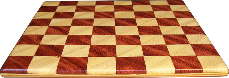 "Cbd Tiny Hb-Bub 3<br /> <br />    This chess board is 8 1/4"" square. Each square is just over 1"" and is made with 2 triangles back to back.  Two types of wood are in the chessboard. The dark square is ""Bubinga"" from Africa, some call it African Rosewood. The light square is ""Hackberry"" from Missouri.  There are 128 pieces in the over lay using two kinds of wood. The edges are rounded with no border.<br /> <br /> Also on the back, I signed it, listed the wood, and dated it. After the date the words ""Foot Cut"" lets you know it was made on the foot powered table saw."