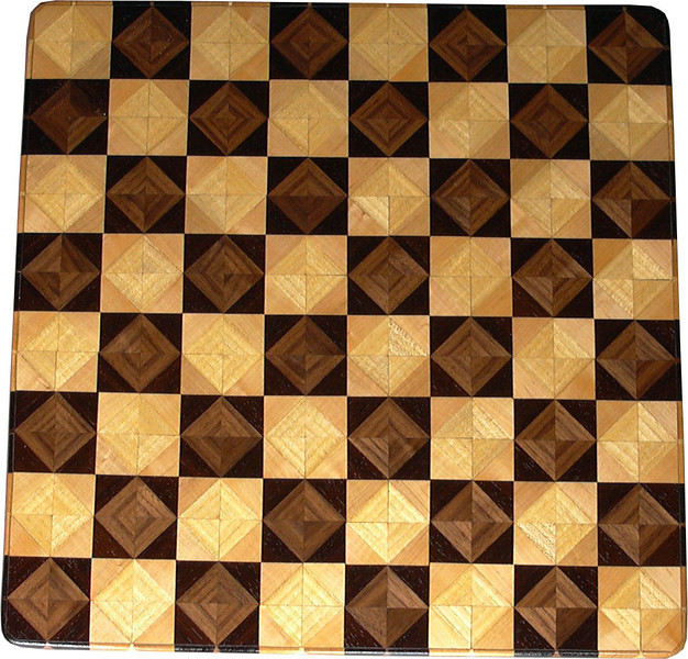 """Chess Board, Walnut-Wenge, Hackberry-Maple<br />  This chess board is 17"""" square.  Each square is just over 2"""" and is made using 8 triangles.  Two types of wood are in each square.  Four kinds of wood are on the chess board.  The dark square has """"Walnut"""" from Missouri, and """"Wenge"""" from West Africa.  The light square has """"Hackberry"""" and """"Maple"""" from Missouri.  There are 612 pieces in the over lay. <br />   <br />     This gives a completely different look to a chess board.  When not being used to play chess, it's made to hang on the wall from one corner.  They make a very beautiful wall hanging."""
