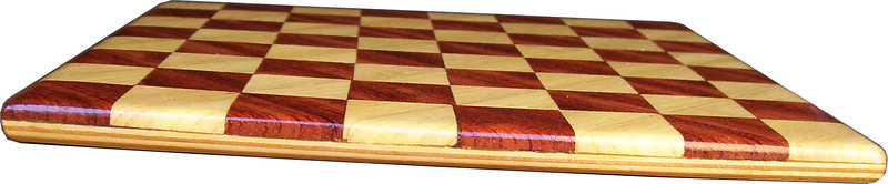 """Cbd Tiny Hb-Bub 4<br />    This chess board is 8 1/4"""" square. Each square is just over 1"""" and is made with 2 triangles back to back.  Two types of wood are in the chessboard. The dark square is """"Bubinga"""" from Africa, some call it African Rosewood. The light square is """"Hackberry"""" from Missouri.  There are 128 pieces in the over lay using two kinds of wood. The edges are rounded with no border.<br /> <br /> Also on the back, I signed it, listed the wood, and dated it. After the date the words """"Foot Cut"""" lets you know it was made on the foot powered table saw."""