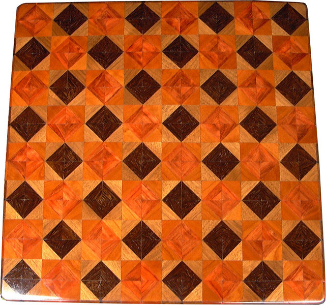"Chess Board, Wenge-Walnut, Bubinga-Cherry<br /> This chess board is 17"" square.  Each square is just over 2"" and is made using 8 triangles. Two types of wood are in each square.  Four kinds of wood are on the chess board.  The dark square has ""Wenge"" from West Africa and ""Walnut"" from Missouri; the light square has ""Bubinga"" from West Africa and ""Cherry"" from Missouri.  There are 612 pieces in the over lay. <br />   <br />    This gives a completely different look to a chess board. In fact, the Walnut and Cherry next to each other makes it hard for me to tell the difference in the light and dark squares. The way I can tell at a glance, is the Wenge and the Bubinga that is on the inside of the dark and the light squares. Some people like the Walnut and cherry together, and the board does have an interesting pattern to it in the light. It would just be hard for me to play on is all.  When not being used as a chess board, it is made to hang on the wall from one corner.  They make a very beautiful wall hanging."