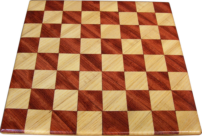 """Cbd Tiny Hb-Bub 2<br />    This chess board is 8 1/4"""" square. Each square is just over 1"""" and is made with 2 triangles back to back.  Two types of wood are in the chessboard. The dark square is """"Bubinga"""" from Africa, some call it African Rosewood. The light square is """"Hackberry"""" from Missouri.  There are 128 pieces in the over lay using two kinds of wood. The edges are rounded with no border.<br /> <br /> Also on the back, I signed it, listed the wood, and dated it. After the date the words """"Foot Cut"""" lets you know it was made on the foot powered table saw."""