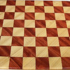 "Cbd Tiny Hb-Bub 2<br />    This chess board is 8 1/4"" square. Each square is just over 1"" and is made with 2 triangles back to back.  Two types of wood are in the chessboard. The dark square is ""Bubinga"" from Africa, some call it African Rosewood. The light square is ""Hackberry"" from Missouri.  There are 128 pieces in the over lay using two kinds of wood. The edges are rounded with no border.<br /> <br /> Also on the back, I signed it, listed the wood, and dated it. After the date the words ""Foot Cut"" lets you know it was made on the foot powered table saw."