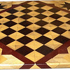 "Cbd Wenge-Hb-Ph with Star 3<br /> This chess board is 11 3/4"" square. Over all the board is 17 ¼"" square. Each square is just under 1 1/2"" and is made with 4 triangles. Two types of wood are in the chessboard. Three kinds of wood are on the whole board. The dark square is ""Wenge"" from West Africa; the light square is ""Hackberry"" from Missouri. ""Purpleheart"" from Central America is around the chessboard itself. The design on the corners is a variation of a ""Rolling Star"" quilt pattern. I use the same wood as is in the chessboard. There are 560 pieces in the over lay using three kinds of wood.<br />  <br /> Also on the back, I signed it, listed the wood, and dated it. After the date the words ""Foot Cut"" let you know I made it on my foot powered table saw. <br /> <br /> This gives a completely different look to a chess board. When not being used as a chess board, it is made to hang on the wall from one corner. They make a very beautiful wall hanging"