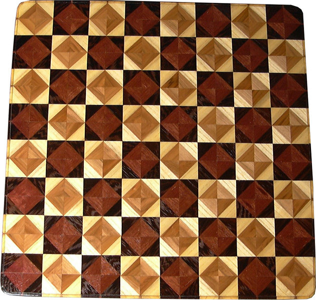 "Cbd Ph_Wenge Red Gum-Hb<br /> <br />   This chess board is 17"" square.  Each square is just over 2"" and is made using 8 triangles.  Two types of wood are in each square.  Four kinds of wood are on the chess board.  The dark square has ""Purpleheart"" from Central or South America, and ""Wenge"" from West Africa.  The light square has ""Red Gum"" from the South Eastern United States, and ""Hackberry"" from Missouri.  There are 612 pieces in the over lay.<br /> <br />   Onthe back, I signed it, listed the wood, dated, and numbered it.  After the date the words ""Foot Cut"" let you know I made it on a foot powered table saw my brother helped me make around 1992.<br /> <br />   This gives a completely different look to a chessboard.  When not being used as a chess board, it is made to hang on the wall from one corner.  It makes a very beautiful wall hanging."