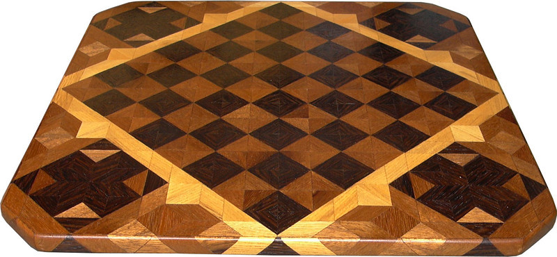 "Cbd Wenge-Phil Mah With Cross. 2<br />    This chessboard is 11 3/4"" square. Over all the board is 17 ¼"" square. Each square is just under 1 1/2"" and is made with 4 triangles.  Two types of wood are in the chessboard. Three kinds of wood are on the whole board.  The dark square is ""Wenge"" from West Africa; the light square is ""Philippine Mahogany"" from the Philippines. ""Hackberry"" from Missouri is around the chessboard itself. The design in each corner is a variation of a ""Rolling Star"" quilt pattern. There are 8 diamonds making a star but I put 4 triangles making a cross and hiding the star. The wood on the cross is ""Wenge"". When the light shines on the ""Philippine Mahogany"" it shines like a new Penny. There are 560 pieces in the over lay, using 3 kinds of wood.<br /> <br />   Also on the back, I signed it, listed the wood, and dated it. This is one of my older chessboards. <br />   <br />    This gives a completely different look to a chessboard.  When not being used as a chessboard, it is made to hang on the wall from one corner.  They make a very beautiful wall hanging."