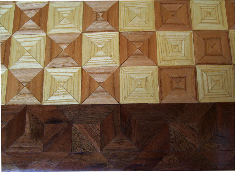 """Cbd 12X18 Elm-Ash-Wal <br /> Close-up<br /> This chess board is 12"""" square, 12 ½"""" X 17 ½"""" over all. Each square is 1 ½"""" and is made using 4 triangles. Three kinds of wood are on the chess board. The dark square is """"Elm""""; the light square is """"Ash"""", """"Walnut"""" is around the chessboard, all from Missouri. There are 418 pieces in the over lay.<br />  <br /> On the back, I signed it, listed the wood, and dated it.<br />  <br /> I tried to match the grain on most of the squares which gives it a unique look. <br /> <br /> This gives a completely different look to a chess board. When not being used as a chess board, it is made to hang on the wall. They make a very beautiful wall hanging."""