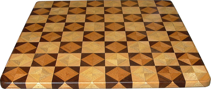 """Chess Board Edge,  Ky Coffee-Walnut, Hackberry-Maple<br /> Showing the side<br /> This chess board is 17"""" square.  Each square is just over 2"""" and is made using 8 triangles.  Two types of wood are in each square.  Four kinds of wood are on the chess board.  The dark square has """"Ky Coffee"""" from Illinois and """"Walnut"""" from Missouri; the light square has """"Hackberry"""" and """"Maple"""" from Missouri.  There are 612 pieces in the over lay.<br />   <br />   This gives a completely different look to a chess board.  When not being used as a chess board, it is made to hang on the wall from one corner.  They make a very beautiful wall hanging."""