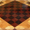 "Cbd Ph-Wenge With Star 4<br />    This chess board is 11 3/4"" square. Over all the board is 17 ¼"" square. Each square is just under 1 1/2"" and is made with 4 triangles.  Two types of wood are in the chessboard. Five kinds of wood are on the whole board.  The dark square is ""Wenge"" from West Africa; the light square is ""Purpleheart"" from Central or South America. The design on the corners is a variation of a ""Rolling Star"" quilt pattern. From the star out is ""Walnut"" ""Hackberry"" and ""Elm"" from Missouri. There are 560 pieces in the over lay using five kinds of wood.<br /> <br />   Also on the back, I signed it, listed the wood, and dated it. After the date the words ""Foot Cut"" let you know I made it on my foot powered table saw."