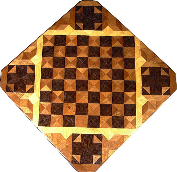 """Cbd Wenge-Phil Mah With Cross. 1<br />    This chessboard is 11 3/4"""" square. Over all the board is 17 ¼"""" square. Each square is just under 1 1/2"""" and is made with 4 triangles.  Two types of wood are in the chessboard. Three kinds of wood are on the whole board.  The dark square is """"Wenge"""" from West Africa; the light square is """"Philippine Mahogany"""" from the Philippines. """"Hackberry"""" from Missouri is around the chessboard itself. The design in each corner is a variation of a """"Rolling Star"""" quilt pattern. There are 8 diamonds making a star but I put 4 triangles making a cross and hiding the star. The wood on the cross is """"Wenge"""". When the light shines on the """"Philippine Mahogany"""" it shines like a new Penny. There are 560 pieces in the over lay, using 3 kinds of wood.<br /> <br />   Also on the back, I signed it, listed the wood, and dated it. This is one of my older chessboards. <br />   <br />    This gives a completely different look to a chessboard.  When not being used as a chessboard, it is made to hang on the wall from one corner.  They make a very beautiful wall hanging."""