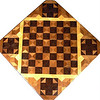 "Cbd Wenge-Phil Mah With Cross. 1<br />    This chessboard is 11 3/4"" square. Over all the board is 17 ¼"" square. Each square is just under 1 1/2"" and is made with 4 triangles.  Two types of wood are in the chessboard. Three kinds of wood are on the whole board.  The dark square is ""Wenge"" from West Africa; the light square is ""Philippine Mahogany"" from the Philippines. ""Hackberry"" from Missouri is around the chessboard itself. The design in each corner is a variation of a ""Rolling Star"" quilt pattern. There are 8 diamonds making a star but I put 4 triangles making a cross and hiding the star. The wood on the cross is ""Wenge"". When the light shines on the ""Philippine Mahogany"" it shines like a new Penny. There are 560 pieces in the over lay, using 3 kinds of wood.<br /> <br />   Also on the back, I signed it, listed the wood, and dated it. This is one of my older chessboards. <br />   <br />    This gives a completely different look to a chessboard.  When not being used as a chessboard, it is made to hang on the wall from one corner.  They make a very beautiful wall hanging."