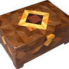 "Deep ASC <br />   I call this my Deep ""Aunt Sukeys Choice"" Box. On the top of the box is an ""Aunt Sukeys Choice"" quilt pattern.  The Deep box is about 9 1/4"" x 6 1/4"" and 4 3/8"" high on the outside. Inside it is 8 1/2"" x 5 1/2"" x 3"".  I made it using 316 pieces of wood cut in either diamond or triangle shapes from different kinds of wood. The box is finished in its natural color with 5 or 6 coats of a clear wiping varnish, rubbed in by hand. The pieces are a bit over 3/16"" thick, glued onto a Baltic Birch base, so hold up much better than a thin veneer.<br />    The type of wood is listed on the bottom of the box from the center out. On this box the wood is ""Purpleheart"" from Central or South America, ""Wenge"" from West Africa, ""Satinwood"" from Sri Lanka, ""Lacewood"" from Australia and ""Walnut"" from Missouri. <br />    On the bottom I signed it, listed the wood, and dated it.  After the date, the words ""Foot Cut"" let you know I made it on a foot powered table saw.<br />  <br />    I lined the box with black velveteen."