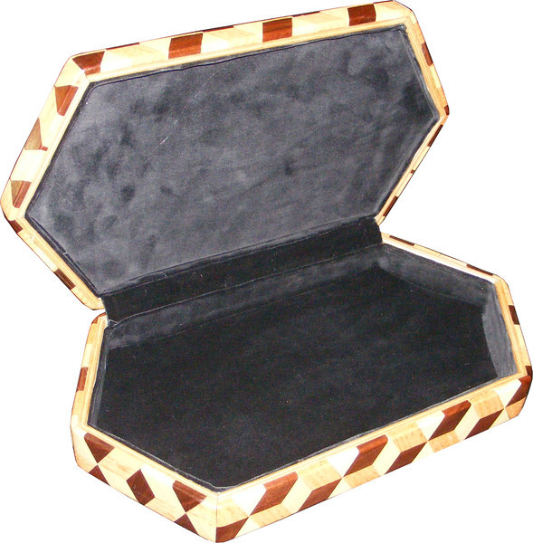 """Large Hexagon Tumbling Block Box, view 3<br /> The large hexagon box is based on the """"Tumbling Block"""" quilt pattern. It measures 7 ¼"""" X 13 3/8"""" and 2 3/8"""" high. Inside measurements are 6 ¼"""" X 12 ¼"""" X 1 ½"""".  There are 304 pieces on the overlay. The pieces are cut and glued in place, one piece at a time. The pattern covers the top and extends over the edge uninterrupted, to the bottom. The box is finished in its natural color with 5 or 6 coats of a clear wiping varnish, rubbed in by hand. The pieces are a bit over 3/16"""" thick, glued onto a Baltic Birch base.<br /> <br /> This box is made from Hackberry, Oak, and Walnut, all native to Missouri. I lined the box with black velveteen.<br /> <br /> The pattern has the illusion of a lot of blocks but there are as many stars as there are blocks. The design forces you to see the blocks. On each diamond, if you go to the side you are in the middle of a block. At each point you are in the middle of a star that has 6 points."""