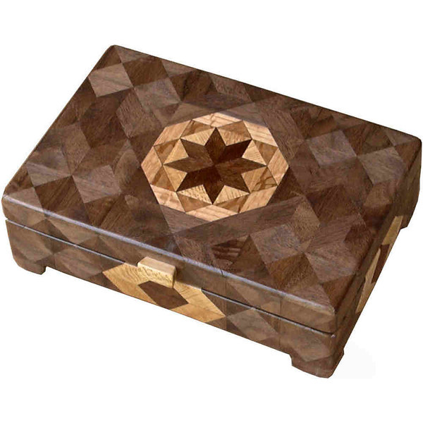 "Flat Brown Tone<br />   I call this my ""Brown Tone"" Glasses Box. On the top of the box is a variation of a ""Rolling Star"" quilt pattern.  The glasses box is about 3 1/2"" x 6 1/2"" and 2 1/4"" high on the outside. Inside it is 2 3/8"" x 5 3/8"" x 1 1/2"".  I made it using 132 pieces of wood cut in either diamond or triangle shapes from different kinds of wood. I used the half size pieces to make the ""Rolling Star"" pattern on top so there are 32 pieces where there would normally be only 16 pieces. The box is finished in its natural color with 5 or 6 coats of a clear wiping varnish, rubbed in by hand. The pieces are a bit over 3/16"" thick, glued onto a Baltic Birch base, so they hold up much better than a thin veneer.<br />   The type of wood is listed on the bottom of the box from the center out. On this box the wood is ""Chechen"" from Mexico, ""Sycamore"" from Missouri, ""Lacewood"" from Australia, ""Oak"" and ""Walnut"" from Missouri.<br />   I made this box in 1997. On the bottom I signed it, listed the wood, and dated it.  After the date, the words ""Foot Cut"" let you know I made it on a foot powered table saw.<br />  <br />   I lined the box with black velveteen."