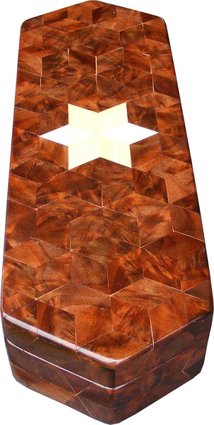 """Long Walnut Burl Hexagon Box, view 2<br /> The Long Walnut Burl Hexagon Box is based on the """"Tumbling Block"""" quilt pattern except that it is all walnut burl but for the six pointed star. It measures 4 3/8"""" X 13 3/8"""" and 2 3/8"""" high. Inside measurements are 3 ¼"""" X 12 1/4"""" X 1 ½"""".  There are 226 pieces on the overlay. The pieces are cut and glued in place, one piece at a time. The pattern covers the top and extends over the edge uninterrupted, to the bottom. The box is finished in its natural color with 5 or 6 coats of a clear wiping varnish, rubbed in by hand. The pieces are a bit over 3/16"""" thick, glued onto a Baltic Birch base.<br /> <br /> This box is made from Hackberry, and Walnut burl, both native to Missouri. I lined the box with black velveteen."""