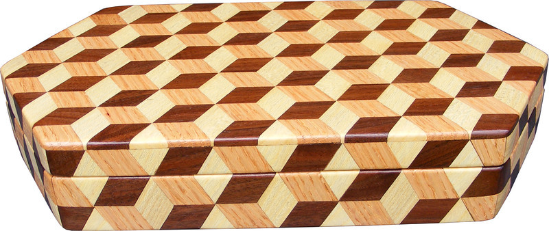 "Large Hexagon Tumbling Block Box, view 1<br /> The large hexagon box is based on the ""Tumbling Block"" quilt pattern. It measures 7 ¼"" X 13 3/8"" and 2 3/8"" high. Inside measurements are 6 ¼"" X 12 ¼"" X 1 ½"".  There are 304 pieces on the overlay. The pieces are cut and glued in place, one piece at a time. The pattern covers the top and extends over the edge uninterrupted, to the bottom. The box is finished in its natural color with 5 or 6 coats of a clear wiping varnish, rubbed in by hand. The pieces are a bit over 3/16"" thick, glued onto a Baltic Birch base.<br /> <br /> This box is made from Hackberry, Oak, and Walnut, all native to Missouri. I lined the box with black velveteen.<br /> <br /> The pattern has the illusion of a lot of blocks but there are as many stars as there are blocks. The design forces you to see the blocks. On each diamond, if you go to the side you are in the middle of a block. At each point you are in the middle of a star that has 6 points."