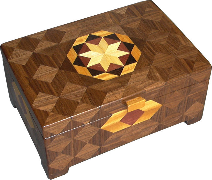 """Deep Bright<br />   I call this my Deep """"Bright"""" Box. On the top of the box is a variation of a """"Rolling Star"""" quilt pattern.  The deep box is about 9 1/4"""" x 6 1/4"""" and 4 3/8"""" high on the outside. Inside it is 8 1/2"""" x 5 1/2"""" x 3"""".  I made it using 332 pieces of wood cut in either diamond or triangle shapes from different kinds of wood. I used the half size pieces for the """"Rolling Star"""" on the top, so there are 32 pieces where I would normally have 16 pieces. The box is finished in its natural color with 5 or 6 coats of a clear wiping varnish, rubbed in by hand. The pieces are a bit over 3/16"""" thick, glued onto a Baltic Birch base, so hold up much better than a thin veneer.<br />   The type of wood is listed on the bottom of the box from the center out. On this box the wood is """"Hackberry"""" from Missouri, """"Purpleheart"""" from Central or South America, """"Wenge"""" from West Africa, """"Satinwood"""" from Sri Lanka and """"Walnut"""" from Missouri.<br />    I made this box in 1997. On the bottom I signed it, listed the wood, and dated it.  After the date, the words """"Foot Cut"""" let you know I made it on a foot powered table saw.<br />  <br />    I lined the box with black velveteen."""