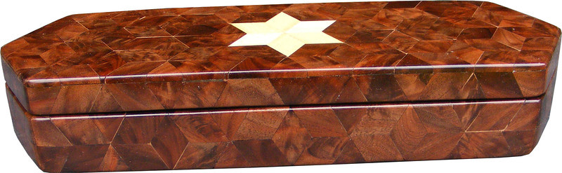 """Long Walnut Burl Hexagon Box, view 1<br /> The Long Walnut Burl Hexagon Box is based on the """"Tumbling Block"""" quilt pattern except that it is all walnut burl but for the six pointed star. It measures 4 3/8"""" X 13 3/8"""" and 2 3/8"""" high. Inside measurements are 3 ¼"""" X 12 1/4"""" X 1 ½"""".  There are 226 pieces on the overlay. The pieces are cut and glued in place, one piece at a time. The pattern covers the top and extends over the edge uninterrupted, to the bottom. The box is finished in its natural color with 5 or 6 coats of a clear wiping varnish, rubbed in by hand. The pieces are a bit over 3/16"""" thick, glued onto a Baltic Birch base.<br /> <br /> This box is made from Hackberry, and Walnut burl, both native to Missouri. I lined the box with black velveteen."""