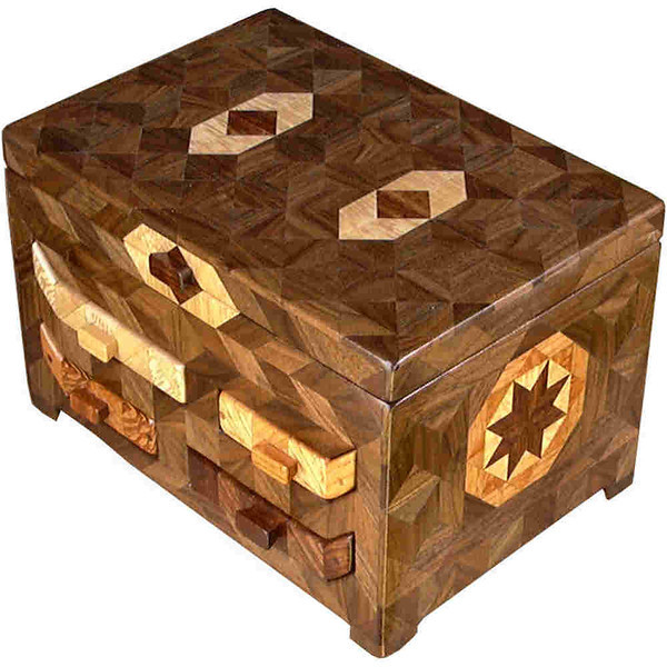 """4 Drawer Brown Tone <br />   I call this my """"Brown Tone 4 Drawer Cabinet"""". On the sides and back of the cabinet is a variation of a """"Rolling Star"""" quilt pattern, in two sizes. On the sides I have 32 pieces in the same area that I have 16 pieces on the back.  The cabinet is about 7 ½"""" tall x 11 1/2"""" wide and 8"""" front to back. I made it using about 629 pieces of wood cut in either diamond or triangle shapes from different kinds of wood. I used the half size pieces for the """"Rolling Star"""" on the sides, so there are 32 pieces where I would normally have 16 pieces. The cabinet is finished in its natural color with 5 or 6 coats of a clear wiping varnish, rubbed in by hand. The pieces are a bit over 3/16"""" thick, glued onto a Baltic Birch base, so hold up much better than a thin veneer.<br />   The type of wood is listed on the bottom of the cabinet, from the center out of the """"Rolling Star"""" quilt pattern on the side or back. On this cabinet the wood is """"Chechen"""" from Mexico, """"Sycamore"""" from Missouri, """"Lacewood"""" from Australia, """"Oak"""" and """"Walnut"""" from Missouri.<br />   The drawer design of the jewelry cabinet makes it unique from all others. The type of wood on the drawer front is listed on the inside of the drawer front along with the number of the cabinet. The number of the cabinet is also listed on the inside on the back. You will see it when you pull the lower right drawer out and look inside at the back. The number of this cabinet is #43. I help hold the drawer together using pegs I make from the same type of wood that is on the drawer face.<br />   I made this cabinet in 1997. On the bottom I signed it, listed the wood, and dated it.  After the date, the words """"Foot Cut"""" let you know I made it on a foot powered table saw. The drawer is cut out on a scroll saw I made to go on the power supply that runs the table saw.<br />   <br />   These look good in front of a mirror, so you can see the design on the back.<br /> <br />   I lined inside the top and the drawer bottoms """