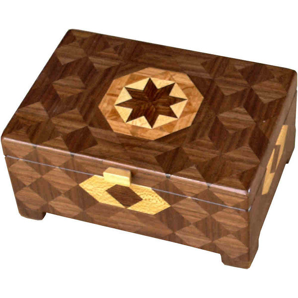 """Deep Brown Tone<br />    I call this my Deep """"Brown Tone"""" Box. On the top of the box is a variation of a """"Rolling Star"""" quilt pattern.  The deep box is about 9 1/4"""" x 6 1/4"""" and 4 3/8"""" high on the outside. Inside it is 8 1/2"""" x 5 1/2"""" x 3"""".  I made it using 332 pieces of wood cut in either diamond or triangle shapes from different kinds of wood. I used the half size pieces for the """"Rolling Star"""" on the top, so there are 32 pieces where I would normally have 16 pieces. The box is finished in its natural color with 5 or 6 coats of a clear wiping varnish, rubbed in by hand. The pieces are a bit over 3/16"""" thick, glued onto a Baltic Birch base, so hold up much better than a thin veneer.<br />    The type of wood is listed on the bottom of the box, from the center out. On this box the wood is """"Chechen"""" from Mexico, """"Sycamore"""" from Missouri, """"Lacewood"""" from Australia, """"Oak"""" and """"Walnut"""" from Missouri.<br />     I made this box in 1997. On the bottom I signed it, listed the wood, and dated it.  After the date, the words """"Foot Cut"""" let you know I made it on a foot powered table saw.<br />  <br />     I lined the box with black velveteen."""