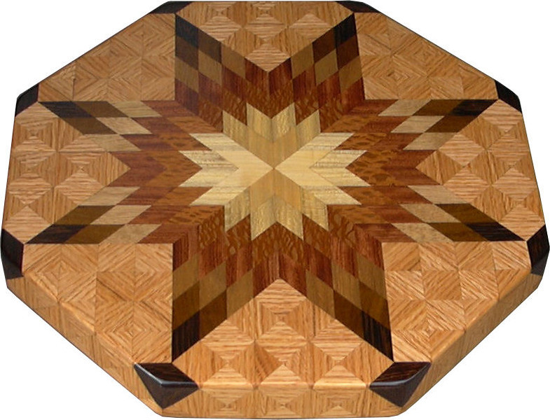 """LS Med Oak 1<br />   This is my """"Medium Oak"""" Lazy Susan.  The measurements are 15 1/2"""" across (17"""" tip to tip) and 2"""" high.  This lazy susan has 8 kinds of wood, all the natural colors.  There are 464 pieces in the overlay, 136 diamonds and 328 triangles.  The type of wood used is listed on the bottom from the center out.  On this lazy susan, starting from the center is """"Cottonwood"""" and """"Hackberry"""" from Missouri, """"Lacewood"""" from Australia, """"Bubinga"""" from West Africa, """"Philippine Mahogany"""" from the Philippines, """"Imbuia"""" from Brazil, """"Wenge"""" from West Africa, and """"Oak"""" from Missouri.<br />   The pattern is based on the """"Lone Star"""" quilt pattern.  The design extends over the edge to within ¼"""" of the table top it sits on.  The stationary base is hidden on the inside, behind the edge."""