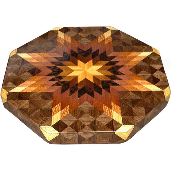 """LS Med Bright 1<br />      This is my """"Medium bright"""" Lazy Susan. The measurements are 15 1/2"""" across (17"""" tip to tip) and 2"""" high. This lazy susan has 8 kinds of wood, all the natural colors. There are 464 pieces in the overlay, 136 diamonds and 328 triangles. The type of wood used is listed on the bottom from the center out. On this lazy susan, starting from the center is """"Satinwood"""" from Sri Lanka, then """"Brunite"""" which I don't have a clue where it is from. I just know it has a nice shine as you turn the lazy susan and let the light hit it from different angles. Then you truly see how wood can shine depending on how the light hits the grain. Next is """"Wenge"""" from West Africa, """"Purpleheart"""" from Central or South America, """"Mahogany"""" from Central America, """"Lacewood"""" from Australia, """"Hackberry"""" and """"Walnut"""" from Missouri.                  <br /> <br />      The pattern is based on the """"Lone Star"""" quilt pattern. The design extends over the edge to within ¼"""" of the table top it sits on. The stationary base is hidden on the inside, behind the edge."""