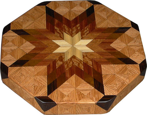 """LS Sm Oak 1<br /> This is my """"Small Oak"""" Lazy Susan.  The measurements are 12"""" across (13"""" tip to tip) and are 2"""" high.  This lazy susan has 6 kinds of wood, all the natural colors.  There are 304 pieces in the overlay, 80 diamonds and 224 triangles.  The type of wood used is listed on the bottom from the center out.  On this lazy susan, starting from the center is """"Hackberry"""" from Missouri, """"Lacewood"""" from Australia, """"Bubinga"""" from West Africa, """"Imbuia"""" from Brazil, """"Wenge"""" from West Africa, and """"Oak"""" from Missouri.<br />   The pattern is based on the """"Lone Star"""" quilt pattern.  The design extends over the edge to within ¼"""" of the table top it sits on.  The stationary base is hidden on the inside, behind the edge."""