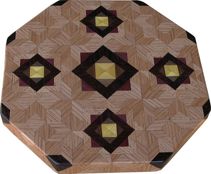 "LS Med ASC Oak 1<br />  This is my ""Medium Aunt Sukeys Choice Oak"" Lazy Susan. The pattern on this lazy susan is the ""Aunt Sukeys Choice"" quilt pattern. It is the same pattern that is on the ""Oak ASC Square Box"" or that is on the large ""Oak Table"". As you can see on the square box, 2 diamonds are on each corner. They form a star when 4 of the patterns come together. Out from the center I have 4 half size patterns that are the same size that is on my ""Oak Tiny Square Box"", twice as many pieces as would normally be in that area, 48 pieces where I would normally have 24 pieces<br /> <br />      The measurements are 15"" across, 15 ½"" diagonal, 16 ½"""" tip to tip, and 2"" high. There are 532 pieces in the overlay, 192 diamonds and 340 triangles. 192 of those pieces are half size pieces <br />      <br />       This lazy susan has 5 kinds of wood, all the natural colors. The type of wood is listed on the bottom from the center out. On this lazy susan the wood is ""Satinwood"" from South America, ""Walnut"" from Missouri, ""Wenge"" from West Africa, ""Purpleheart"" from Central or South America, and ""Oak"" from Missouri.<br />       The pattern is based on the ""Aunt Sukeys Choice"" quilt pattern. The design extends over the edge to within ¼"" of the table top it sits on. The stationary base is hidden on the inside, behind the edge."