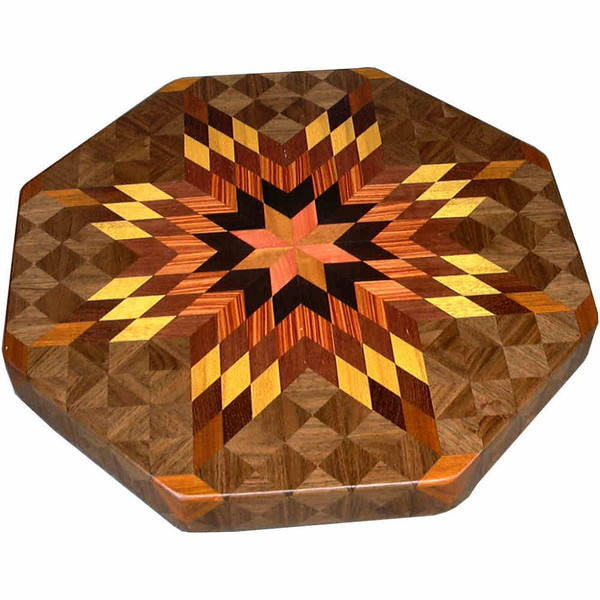 """LS Med High Bright 1<br />   This is my """"Medium High Bright"""" lazy susan. The measurements are 15 1/2"""" across (17"""" tip to tip) and is 2"""" high. This lazy susan has 8 kinds of wood, all the natural colors. There are 464 pieces in the overlay, 136 diamonds and 328 triangles. The """"Exotic"""" wood on this lazy susan makes it have the same price as one of my large lazy susans. The type of wood used is listed on the bottom from the center out. On this lazy susan, starting from the center is """"Pink Ivory"""" from South Africa, """"Ebony"""" from West Africa, """"Tulipwood"""" from Brazil, """"Purpleheart"""" from Central or South America, """"Satinwood"""" from Brazil, """"Honduras Rosewood"""" from Honduras, """"Canary wood"""" from South America, then """"Walnut"""" from Missouri. <br /> <br />    The pattern is based on the """"Lone Star"""" quilt pattern. The design extends over the edge to within ¼"""" of the table top it sits on. The stationary base is hidden on the inside, behind the edge."""