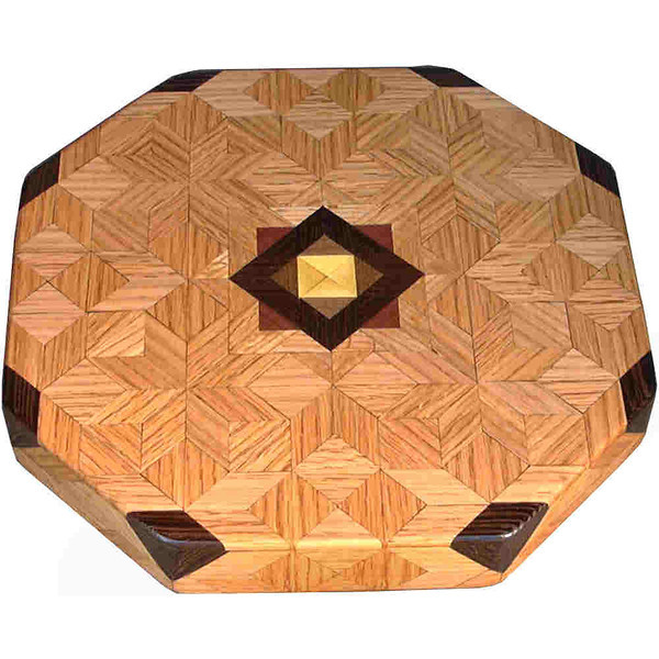 """LS Sm ASC Oak 1<br />    This is my """"Small Aunt Sukeys Choice Oak"""" Lazy Susan. The pattern on this lazy susan is the """"Aunt Sukeys Choice"""" quilt pattern. It is the same pattern that is on the """"Oak ASC Square Box"""". As you can see on the square box, 2 diamonds are on each corner. They form a star when 4 of the patterns come together. In the center I start with the pattern half sized (twice as many pieces as would normally be in that area, 48 pieces where I would normally have 24 pieces). Then I continue with the regular sized pieces on out to the edge.<br /> <br />      The measurements are 11 ½"""" across, 12"""" diagonal, 12 ½"""""""" tip to tip, and 2"""" high. There are 300 pieces in the overlay, 120 diamonds and 180 triangles. 48 of those pieces are half size pieces <br />      <br />       This lazy susan has 5 kinds of wood, all the natural colors. The type of wood is listed on the bottom from the center out. On this lazy susan the wood is """"Satinwood"""" from South America, """"Walnut"""" from Missouri, """"Wenge"""" from West Africa, """"Purpleheart"""" from Central or South America, and """"Oak"""" from Missouri.<br />       The pattern is based on the """"Aunt Sukeys Choice"""" quilt pattern. The design extends over the edge to within ¼"""" of the table top it sits on. The stationary base is hidden on the inside, behind the edge."""