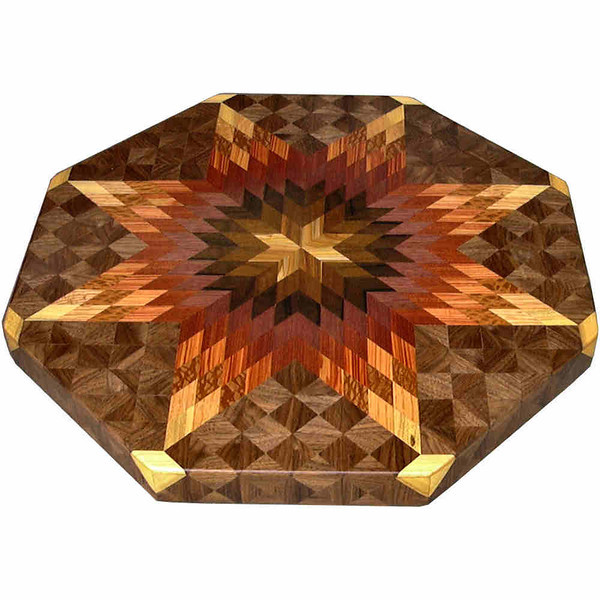 """LS Lg Bright 1<br />    This is my """"Large Bright"""" Lazy Susan. The measurements are 19"""" across (21"""" tip to tip) and 2"""" high. This lazy susan has 10 kinds of wood, all the natural colors. There are 656 pieces in the overlay, 208 diamonds and 428 triangles. The type of wood used is listed on the bottom from the center out. On this lazy susan, starting from the center is """"Smoke Tree"""" from Missouri, """"Imbuia"""" from Brazil, """"Zoracote"""" from Central America, """"Purpleheart"""" from Central or South America, """"Bloodwood"""" and """"Tulipwood"""" from Brazil, """"Lacewood"""" from Australia, """"Oak"""", """"Hackberry"""" and """"Walnut"""" from Missouri.                  <br />    The pattern is based on the """"Lone Star"""" quilt pattern. The design extends over the edge to within ¼"""" of the table top it sits on. The stationary base is hidden on the inside, behind the edge."""