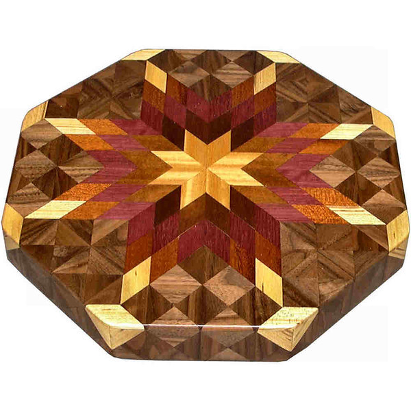 """LS Sm Bright 1<br />  This is my """"Small Bright"""" Lazy Susan. The measurements are 12"""" across (13"""" tip to tip) and 2"""" high. This lazy susan has 6 kinds of wood, all the natural colors. There are 304 pieces in the overlay, 80 diamonds and 224 triangles. The type of wood used is listed on the bottom from the center out. On this lazy susan, starting from the center is """"Satinwood"""" from Sri Lanka, then """"Brunite"""" which I don't have a clue where it is from. I just know it has a nice shine as you turn the lazy susan and let the light hit it from different angles. Then you truly see how wood can shine depending on how the light hits the grain. Next is """"Purpleheart"""" from Central or South America, """"Mahogany"""" from Central America, """"Ash"""" and """"Walnut"""" from Missouri,                  <br /> <br />      The pattern is based on the """"Lone Star"""" quilt pattern. The design extends over the edge to within ¼"""" of the table top it sits on. The stationary base is hidden on the inside, behind the edge."""