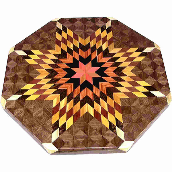 """LS Lg Flickering Star Wal<br />    This is my """"Large Walnut Flickering Star"""" Lazy Susan.  The measurements are 19"""" across (21"""" tip to tip) and 2"""" high.  This lazy susan has 10 kinds of wood, all the natural colors.  There are 656 pieces in the overlay, 208 diamonds and 448 triangles.  The type of wood used is listed on the bottom from the center out.  On this lazy susan, starting from the center is (1) """"Pink Ivory"""" from South Africa, (2) """"Ebony"""" from Africa, (3) """"Tulipwood"""" from Brazil, (4) """"Wenge"""" from West Africa, (5) """"Satinwood"""" from Sri Lanka, (6) """"Purpleheart"""" from Central or South America. (7) """"Satinwood"""" from Brazil, (8) """"Black Palm"""" from Indonesia, (9) """"Hackberry"""" from the U.S. and (10) """"Walnut"""" from Missouri.<br /> <br />    The alternating light and dark rows give the star the illusion of movement like its """"Flickering"""".<br /> <br />    The pattern is based on the """"Lone Star"""" quilt pattern.  The design extends over the edge to within ¼"""" of the table top it sits on.  The stationary base is hidden on the inside, behind the edge."""