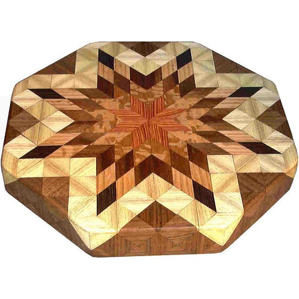 """LS Sm With Hb 1<br />   This is my """"Small with Hackberry"""" Lazy Susan. The measurements are 12"""" across (13"""" tip to tip) and 2"""" high. This lazy susan has 7 kinds of wood, all the natural colors. There are 304 pieces in the overlay, 80 diamonds and 224 triangles. The type of wood used is listed on the bottom from the center out. On this lazy susan, starting from the center is """"Tulipwood"""" from Brazil, a member of the rosewood family. """"Lacewood"""" from Australia, """"Chechen"""" from Mexico, """"Oak"""" from Missouri, """"Wenge"""" from West Africa, """"Hackberry"""" and """"Walnut"""" from Missouri,                  <br /> <br />      The pattern is based on the """"Lone Star"""" quilt pattern. The design extends over the edge to within ¼"""" of the table top it sits on. The stationary base is hidden on the inside, behind the edge."""