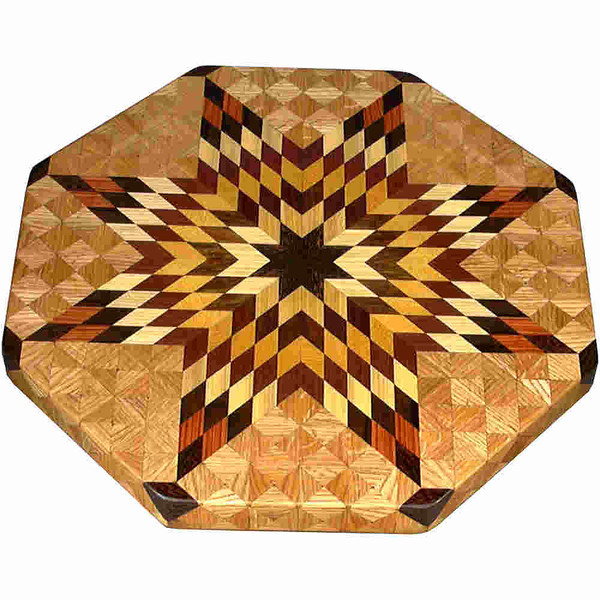"LS Lg Flickering Star Oak 1<br />  This is my ""Large Oak Flickering Star"" Lazy Susan.  The measurements are 19"" across (21"" tip to tip) and 2"" high.  This lazy susan has 10 kinds of wood, all the natural colors.  There are 656 pieces in the overlay, 208 diamonds and 448 triangles.  The type of wood used is listed on the bottom from the center out.  On this lazy susan, starting from the center is (1) ""Black Palm"" from Indonesia, (2) ""Tree Of Heaven"" from the U.S. but native to China, (3) ""Chechen"" from Mexico, (4) ""Satinwood"" from Brazil, (5) ""Purpleheart"" from Central or South America, (6) ""Hackberry"" from the U.S. (7) ""Zaracote"" from Mexico, (8) ""Tulipwood"" from Brazil, (9) ""Wenge"" from West Africa, and (10) ""Oak"" from Missouri.<br /> <br />    The alternating light and dark rows give the star the illusion of movement like its ""Flickering"".<br /> <br />    The pattern is based on the ""Lone Star"" quilt pattern.  The design extends over the edge to within ¼"" of the table top it sits on.  The stationary base is hidden on the inside, behind the edge."