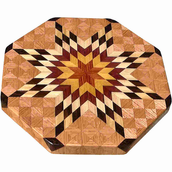 """LS Med Bright Oak<br />    This is my """"Medium Bright Oak"""" Lazy Susan.  The measurements are 15 1/2"""" across (17"""" tip to tip) and 2"""" high.  This lazy susan has 8 kinds of wood, all the natural colors.  There are 464 pieces in the overlay, 136 diamonds and 328 triangles.  The type of wood used is listed on the bottom from the center out.  On this lazy susan, starting from the center is (1) """"Tulipwood"""" and (2) """"Satinwood"""" from Brazil, (3) """"Purpleheart"""" from Central or South America, (4) """"Hackberry"""" from Missouri, (5) """"Ziricote"""" from Mexico, (6) """"Tree Of Heaven"""" from the US but native to China, (7) """"Wenge"""" from West Africa, and (6) """"Oak"""" from Missouri.<br /> <br />    The alternating light and dark rows give the star the illusion of movement like its """"Flickering"""".<br /> <br />    The pattern is based on the """"Lone Star"""" quilt pattern.  The design extends over the edge to within ¼"""" of the table top it sits on.  The stationary base is hidden on the inside, behind the edge."""