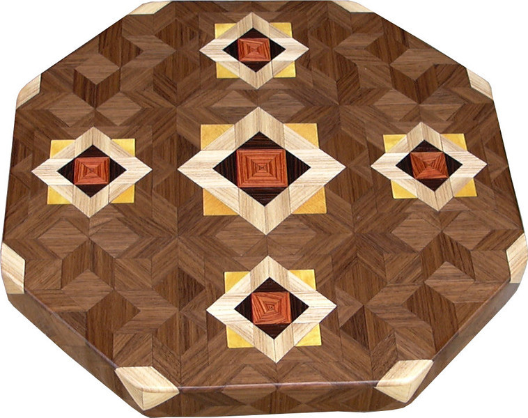 "LS Med ASC Hb 1<br />    This is my ""Medium Aunt Sukeys Choice Hackberry"" Lazy Susan. The pattern on this lazy susan is the ""Aunt Sukeys Choice"" quilt pattern. It is the same pattern that is on the ""Oak ASC Square Box"". As you can see on the square box, 2 diamonds are on each corner. They form a star when 4 of the patterns come together. Out from the center I have 4 half size patterns that are the same size that is on my ""Oak Tiny Square Box"", twice as many pieces as would normally be in that area, 48 pieces where I would normally have 24 pieces<br /> <br />      The measurements are 15"" across, 15 ½"" diagonal, 16 ½"""" tip to tip, and 2"" high. There are 532 pieces in the overlay, 192 diamonds and 340 triangles. 192 of those pieces are half size pieces <br />      <br />       This lazy susan has 5 kinds of wood, all the natural colors. The type of wood is listed on the bottom from the center out. On this lazy susan the wood is ""Tulipwood"" from Brazil, ""Wenge"" from West Africa, ""Hackberry from Missouri, ""Satinwood"" from Brazil and ""Walnut"" from Missouri<br />       The pattern is based on the ""Aunt Sukeys Choice"" quilt pattern. The design extends over the edge to within ¼"" of the table top it sits on. The stationary base is hidden on the inside, behind the edge."