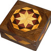 """Sq Bright<br />    I call this my Square """"Bright"""" Box. On the top of the box is a variation of a """"Rolling Star"""" quilt pattern.  The square box is about 5"""" x 5"""" and 2 1/2"""" high on the outside. Inside it is 4"""" x 4"""" x 1 1/2"""".  I made it using 132 pieces of wood cut in either diamond or triangle shapes from different kinds of wood. I used the half size pieces for the """"Rolling Star"""" on the top, so there are 32 pieces where I would normally have 16 pieces. The box is finished in its natural color with 5 or 6 coats of a clear wiping varnish, rubbed in by hand. The pieces are a bit over 3/16"""" thick, glued onto a Baltic Birch base, so they hold up much better than a thin veneer.<br />    The type of wood is listed on the bottom of the box from the center out. On this box the wood is """"Hackberry"""" from Missouri, """"Purpleheart"""" from Central or South America, """"Wenge"""" from West Africa, """"Satinwood"""" from Sri Lanka and """"Walnut"""" from Missouri.<br />    I made this box in 1997. On the bottom I signed it, listed the wood, and dated it.  After the date, the words """"Foot Cut"""" let you know I made it on a foot powered table saw.<br />  <br />    I lined the box with black velveteen."""