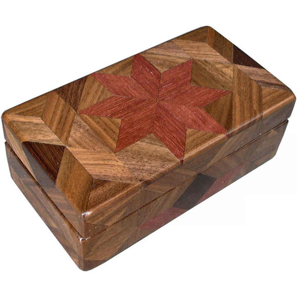 "Purpleheart Glasses Box<br /> I call this my ""Purpleheart"" Glasses Box. On the top of the box is a variation of a ""Rolling Star"" quilt pattern.  The glasses box is about 3 1/2"" x 6 1/2"" and 2 1/4"" high on the outside. Inside it is 2 3/8"" x 5 3/8"" x 1 1/2"".  I made it using 116 pieces of wood cut in either diamond or triangle shapes from different kinds of wood. The box is finished in its natural color with 5 or 6 coats of a clear wiping varnish, rubbed in by hand. The pieces are a bit over 3/16"" thick, glued onto a Baltic Birch base, so they hold up much better than a thin veneer.<br /> The type of wood is listed on the bottom of the box from the center out. On this box the wood is ""Purpleheart"" from Central or South America, ""Walnut"" from Missouri and ""Wenge"" from West Africa.<br />   On the bottom I signed it, listed the wood, and dated it.  After the date, the words ""Foot Cut"" let you know I made it on a foot powered table saw.<br />  <br /> I lined the box with black velveteen."