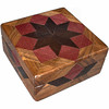 """Purpleheart Square Box<br />    I call this my Square """"Purpleheart"""" Box. On the top of the box is a """"Rolling Star"""" quilt pattern. The square box is about 5"""" x 5"""" and 2 1/2"""" high on the outside. Inside it is 4"""" x 4"""" x 1 1/2"""".  I made it using 116 pieces of wood cut in either diamond or triangle shapes from different kinds of wood. The box is finished in its natural color with 5 or 6 coats of a clear wiping varnish, rubbed in by hand. The pieces are a bit over 3/16"""" thick, glued onto a Baltic Birch base, so they hold up much better than a thin veneer.<br />    The type of wood is listed on the bottom of the box from the center out. On this box the wood is """"Wenge"""" from West Africa, """"Purpleheart"""" from Central or South America and """"Walnut"""" from Missouri.<br />      On the bottom I signed it, listed the wood, and dated it.  After the date, the words """"Foot Cut"""" let you know I made it on a foot powered table saw.<br />  <br />     I lined the box with black velveteen."""