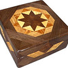 """Sq Brown Tone<br /> I call this my Square """"Brown Tone"""" Box. On the top of the box is a variation of a """"Rolling Star"""" quilt pattern.  The square box is about 5"""" x 5"""" and 2 1/2"""" high on the outside. Inside it is 4"""" x 4"""" x 1 1/2"""".  I made it using 132 pieces of wood cut in either diamond or triangle shapes from different kinds of wood. I used the half size pieces for the """"Rolling Star"""" on the top, so there are 32 pieces where I would normally have 16 pieces. The box is finished in its natural color with 5 or 6 coats of a clear wiping varnish, rubbed in by hand. The pieces are a bit over 3/16"""" thick, glued onto a Baltic Birch base, so they hold up much better than a thin veneer.<br />   The type of wood is listed on the bottom of the box from the center out. On this box the wood is """"Chechen"""" from Mexico, """"Sycamore"""" from Missouri, """"Lacewood"""" from Australia, """"Oak"""" and """"Walnut"""" from Missouri.<br />    I made this box in 1997. On the bottom I signed it, listed the wood, and dated it.  After the date, the words """"Foot Cut"""" let you know I made it on a foot powered table saw.<br />  <br />    I lined the box with black velveteen."""