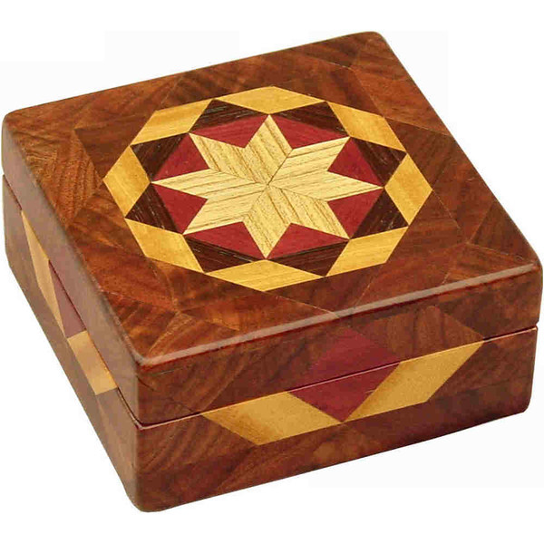 """Walnut Burl Square Box<br />  I call this my Square """"Walnut Burl"""" Box. It is the same as the """"Bright"""" box except it has walnut burl. On the top of the box is a variation of a """"Rolling Star"""" quilt pattern.  The square box is about 5"""" x 5"""" and 2 1/2"""" high on the outside. Inside it is 4"""" x 4"""" x 1 1/2"""".  I made it using 132 pieces of wood cut in either diamond or triangle shapes from different kinds of wood. I used the half size pieces for the """"Rolling Star"""" on the top, so there are 32 pieces where I would normally have 16 pieces. The box is finished in its natural color with 5 or 6 coats of a clear wiping varnish, rubbed in by hand. The pieces are a bit over 3/16"""" thick, glued onto a Baltic Birch base, so they hold up much better than a thin veneer.<br />   The type of wood is listed on the bottom of the box from the center out. On this box the wood is """"Hackberry"""" from Missouri, """"Purpleheart"""" from Central or South America, """"Wenge"""" from West Africa, """"Satinwood"""" from Sri Lanka and """"Walnut Burl"""" from Missouri.<br />    On the bottom I signed it, listed the wood, and dated it.  After the date, the words """"Foot Cut"""" let you know I made it on a foot powered table saw.<br />  <br />    I lined the box with black velveteen."""