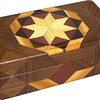 """Glasses Box High Bright<br /> I call this my """"Bright"""" Glasses Box. On the top of the box is a variation of a """"Rolling Star"""" quilt pattern.  The glasses box is about 3 1/2"""" x 6 1/2"""" and 2 1/4"""" high on the outside. Inside it is 2 3/8"""" x 5 3/8"""" x 1 1/2"""".  I made it using 132 pieces of wood cut in either diamond or triangle shapes from different kinds of wood. I used the half size pieces to make the """"Rolling Star"""" pattern on top so there are 32 pieces where there would normally be only 16 pieces. The box is finished in its natural color with 5 or 6 coats of a clear wiping varnish, rubbed in by hand. The pieces are a bit over 3/16"""" thick, glued onto a Baltic Birch base, so they hold up much better than a thin veneer.<br />  The type of wood is listed on the bottom of the box from the center out. On this box the wood is """"Hackberry"""" from Missouri, """"Purpleheart"""" from central or South America, """"Wenge"""" from West Africa, """"Satinwood"""" from Sri Lanka and """"Walnut"""" from Missouri.<br />  I made this box in 1997. On the bottom I signed it, listed the wood, and dated it.  After the date, the words """"Foot Cut"""" let you know I made it on a foot powered table saw.<br />  <br /> I lined the box with black velveteen."""