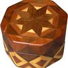 "Oct Box High Light behind Star<br />  This Octagon Box measures 5"" x 5"" and is 3 ¼"" tall.  There are 128 pieces on the box in the diamond and triangle shape.  The box is finished in its natural color with 5 or 6 coats of a clear wiping varnish rubbed in by hand.  The pieces are a bit over 3/16"" thick glued onto a Baltic Birch base.  The type of wood is listed on the bottom of the box from the center out.  On this box is ""Walnut"" and ""Cedar"" from Missouri.<br /> <br />    This box looks like it has a light behind the star. The extra matching of the grain on the side, where the cedar heartwood meets the sapwood, gives this box a higher price.<br />  It is lined with black velveteen."