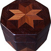 "Oct Box Wal-Wenge<br />  This Octagon Box measures 5"" x 5"" and is 3 ¼"" tall.  There are 128 pieces on the box in the diamond and triangle shape.  The box is finished in its natural color with 5 or 6 coats of a clear wiping varnish rubbed in by hand.  The pieces are a bit over 3/16"" thick glued onto a birch plywood base.  The type of wood is listed on the bottom of the box from the center out.  On this box is ""Walnut"" from Missouri and ""Wenge"" from West Africa.  It is lined with black velveteen."