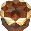 "Oct Box Wal-Bub-HB<br />   This Octagon Box measures 5"" x 5"" and is 3 ¼"" tall.  There are 128 pieces on the box in the diamond and triangle shape.  The box is finished in its natural color with 5 or 6 coats of a clear wiping varnish rubbed in by hand.  The pieces are a bit over 3/16"" thick glued onto a birch plywood base.  The type of wood is listed on the bottom of the box from the center out.  On this box is ""Walnut from Missouri, ""Bubinga"" from Africa and ""Hackberry"" from Missouri.  It is lined with rust colored velveteen."